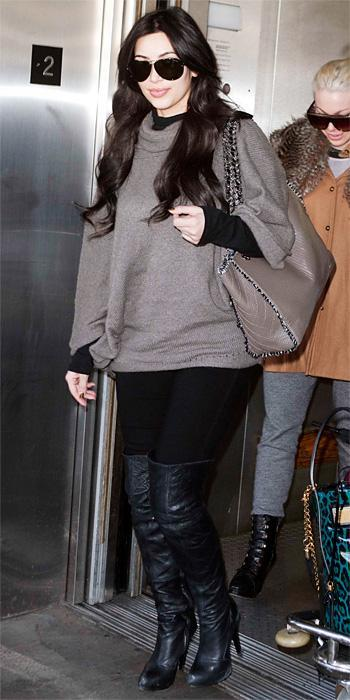 किम Kardashian 2011 Looks - cape top, American Apparel turtleneck, and 7 For All Mankind leggings