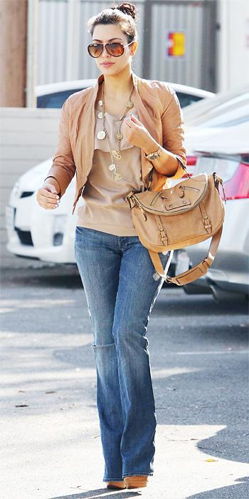 किम Kardashian 2011 Looks - flared jeans and a tan leather jacket