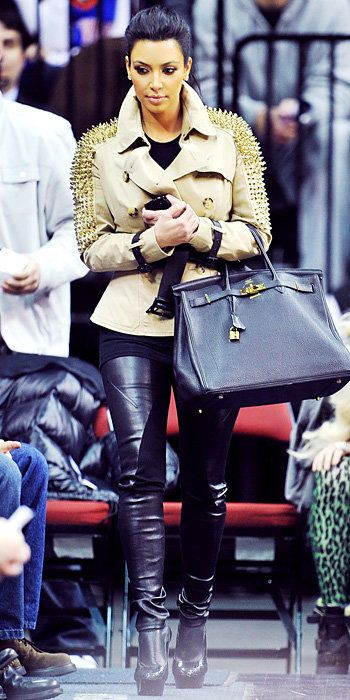 किम Kardashian 2011 Looks - studded Burberry jacket, leather leggings, and Pierre Hardy booties