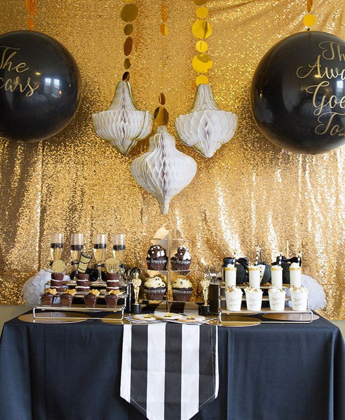 ए Tuxedo Black and Gold Oscars Party