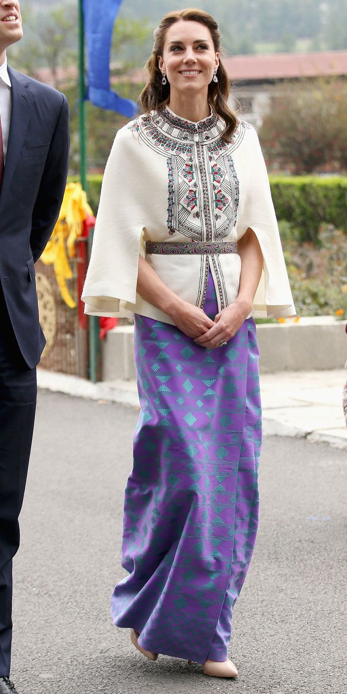 कैथरीन, Duchess of Cambridge walks with Prince William, Duke of Cambridge as part of a ceremonial Chipdrel on arrival into the Tashichhodzong (fortress) on the first day of a two day visit to Bhutan on the 14th April 2016 in Paro, Bhutan. The Royal cou
