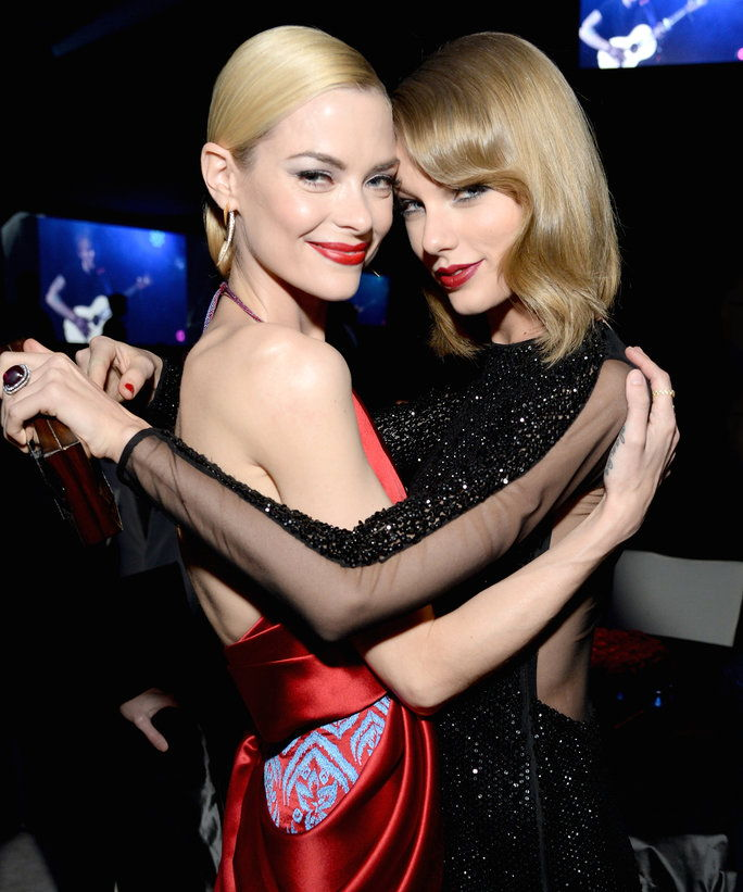 WEST HOLLYWOOD, CA - MARCH 02: Actress Jaime King (L) and recording artist Taylor Swift attend the 22nd Annual Elton John AIDS Foundation Academy Awards Viewing Party at The City of West Hollywood Park on March 2, 2014 in West Hollywood, California.