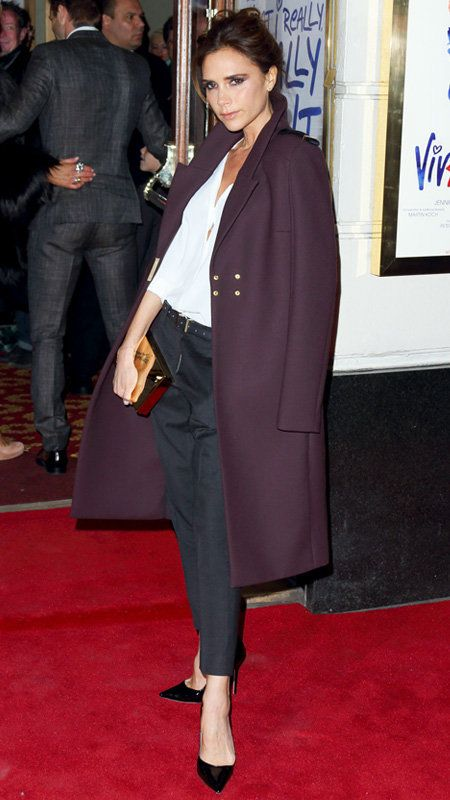 विक्टोरिया Beckham with navy pants, white button down, and plum coat