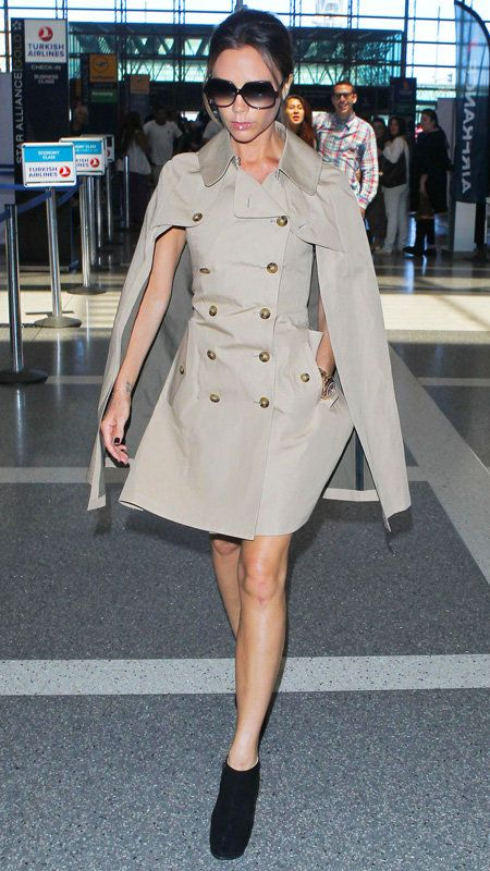 विक्टोरिया Beckham wearing tan double button trench cape coat