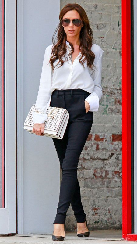 विक्टोरिया Beckham with white button-down and black pants white oversized clutch