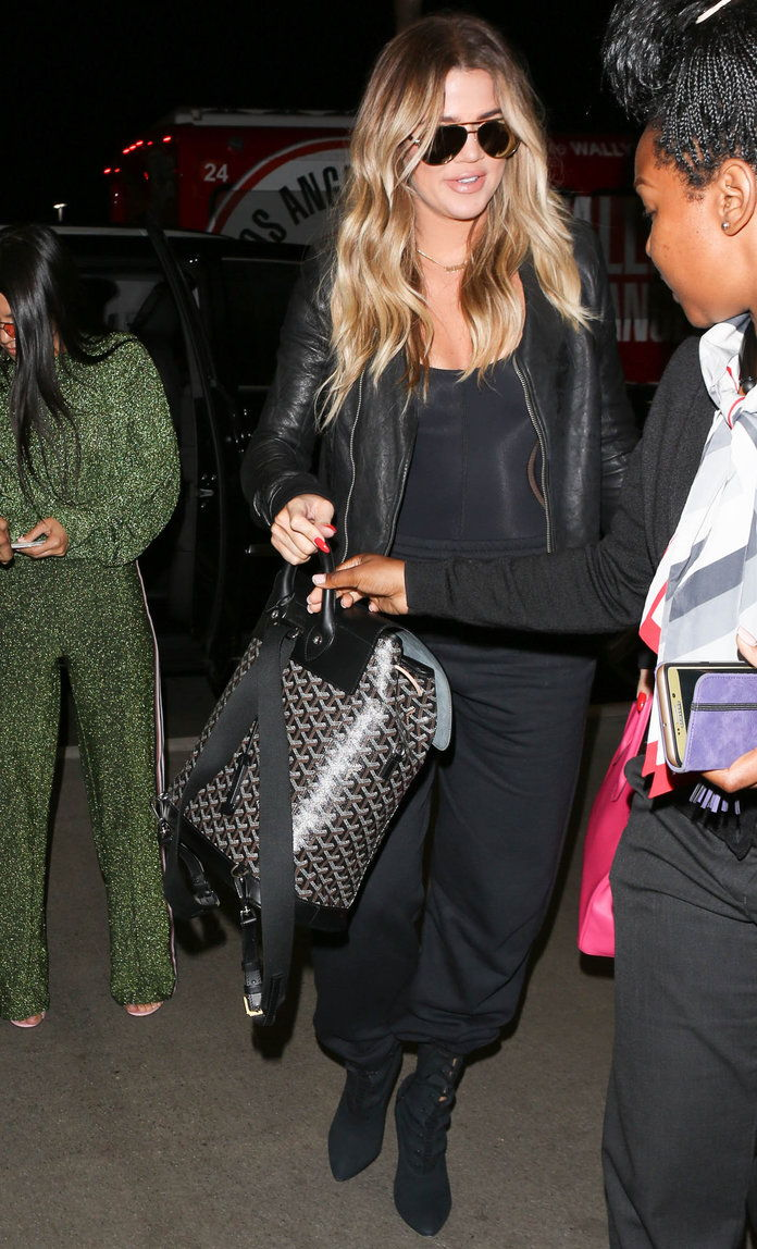 Khloe Kardashian Carries Goyard Back at the Airport